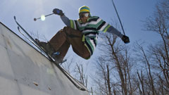 Skier grinding an edge at the terrain park on Whiteface Mountain