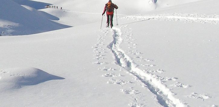 person cross-country skiing through deep snow