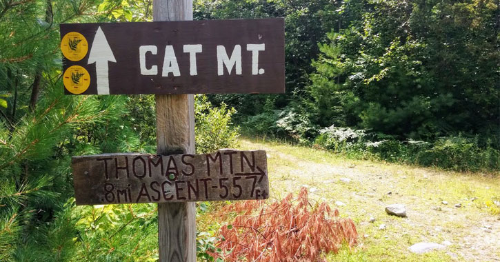 signs for Cat Mountain and Thomas Mountain on a trail
