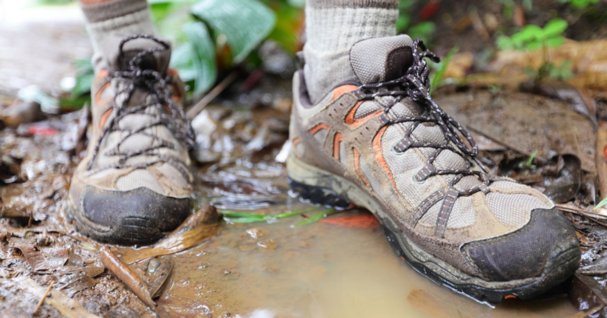 hiking boots on muddy trail