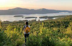 woman hiker overlooks summit