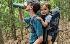 dad with kid in backpack carrier
