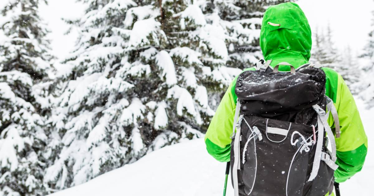 winter hiker with bright green jacket