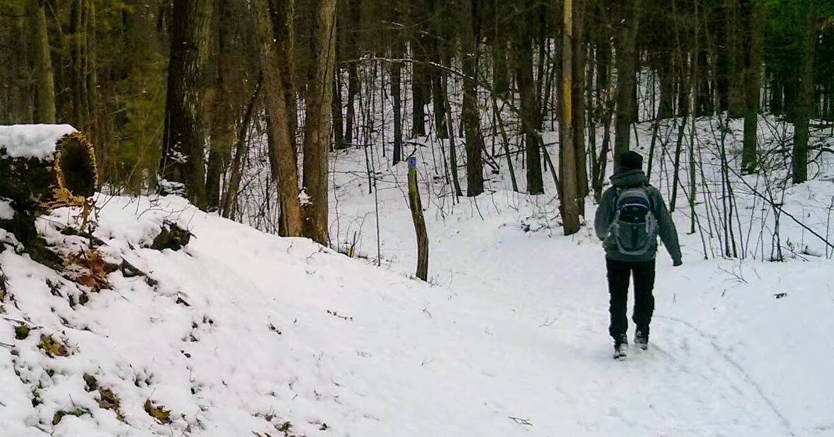 woman hikes with backpack