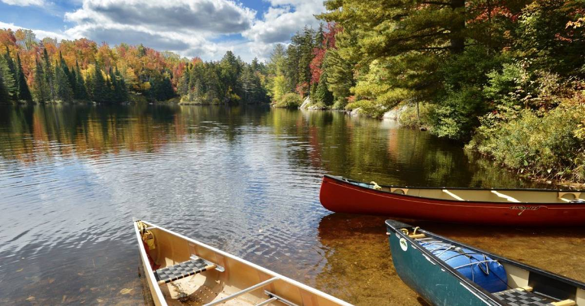 canoes by water in the fall