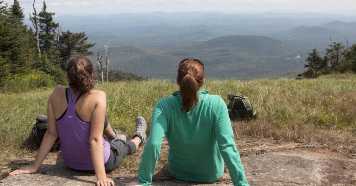 women hikers rest