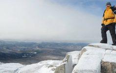 man on summit in winter