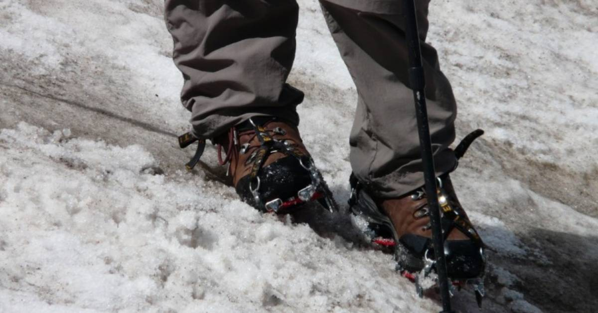close up of crampons in snow