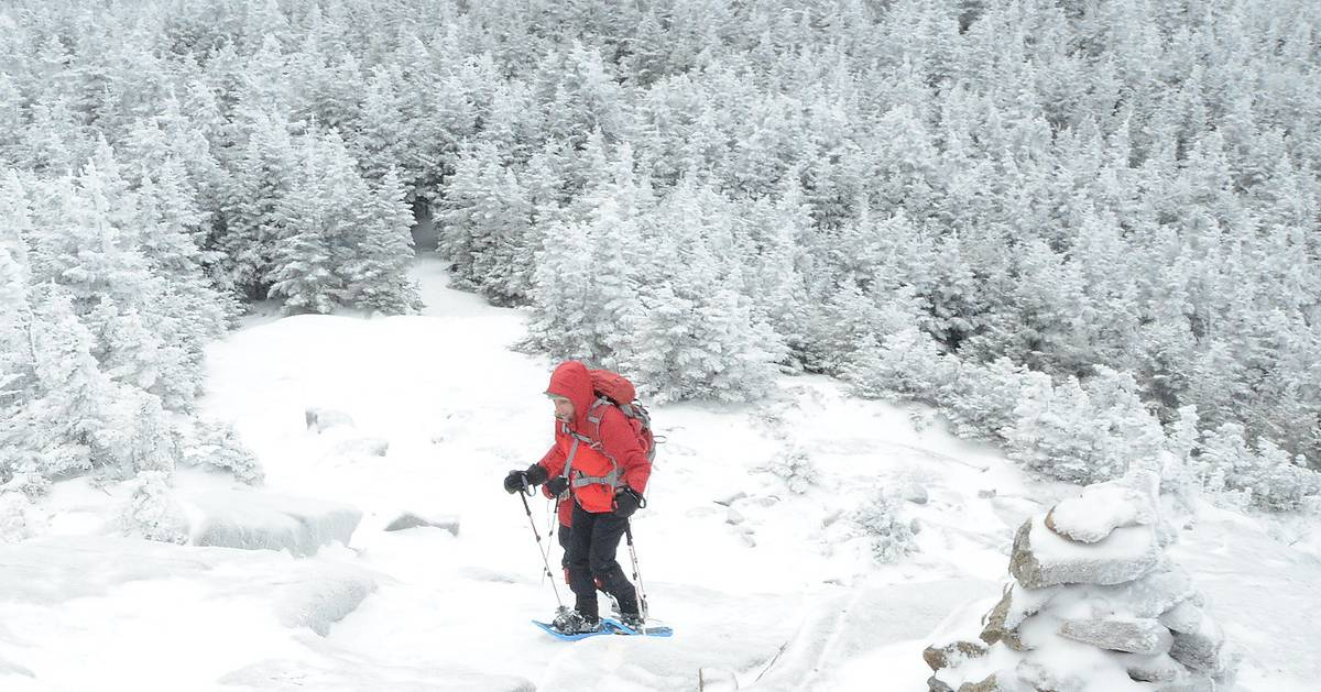 winter hiker with snowshoes