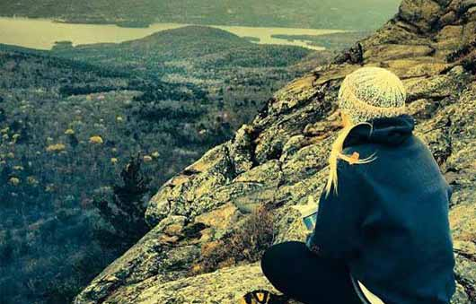 girl sitting on summit