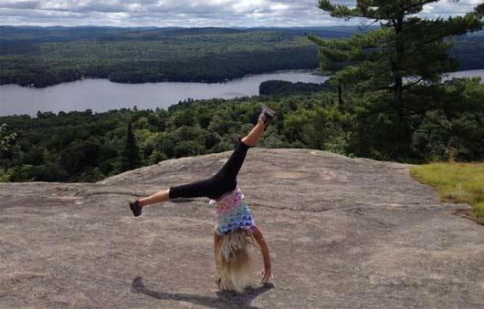 girl cartwheeling on mountain