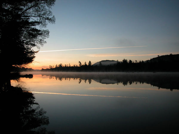still morning with light fog over water