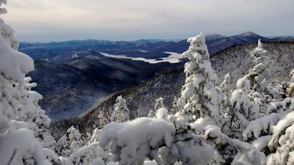 snow covered strees overlooking lake placid