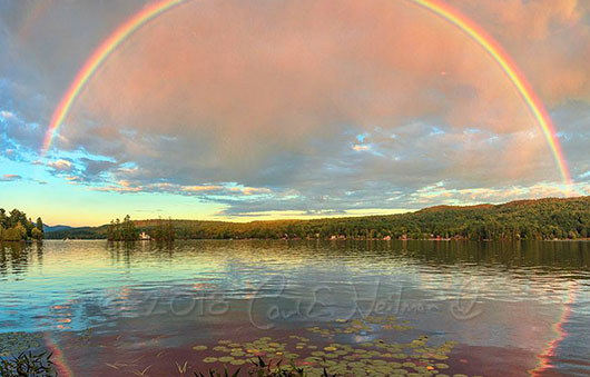 rainbow reflecting on the water