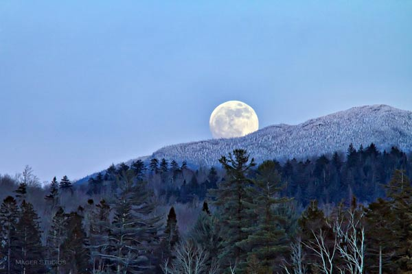 Wolf moon rising over Adirondack mountains