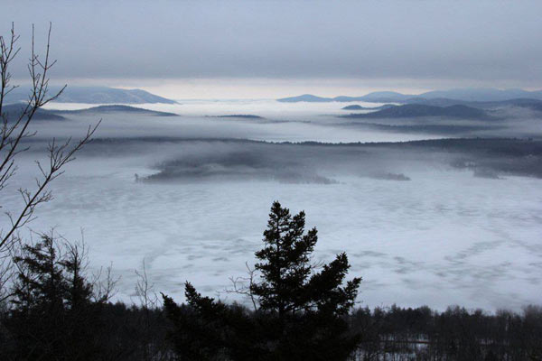 Fog and clouds shrouding hills and peaks