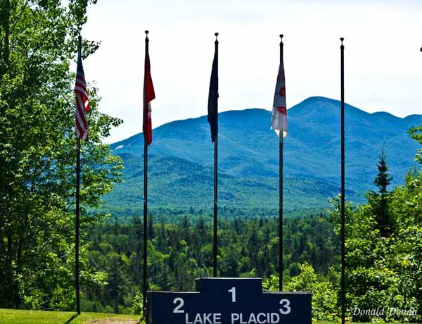 Olympic medal stand backed by flags Whiteface Mountain