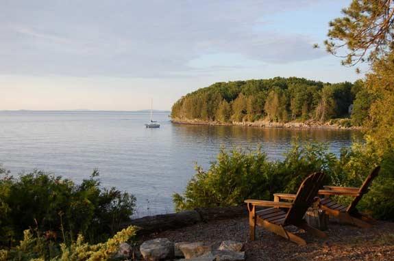 Adirondack chairs on the lake shore