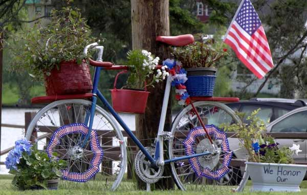 Patriotic bicycle covered in flower pots