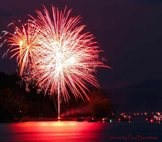 Red fireworks bursting over Great Sacandaga Lake