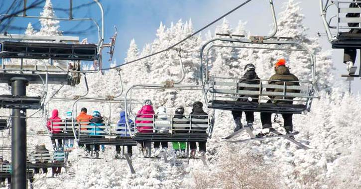 ski chair lift full of people