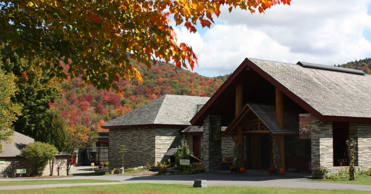 exterior of the adirondack experience museum in the fall