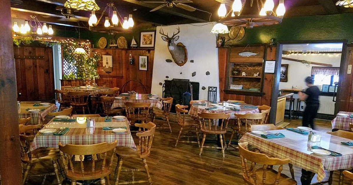 an Adirondack-style restaurant with deer head on the wall