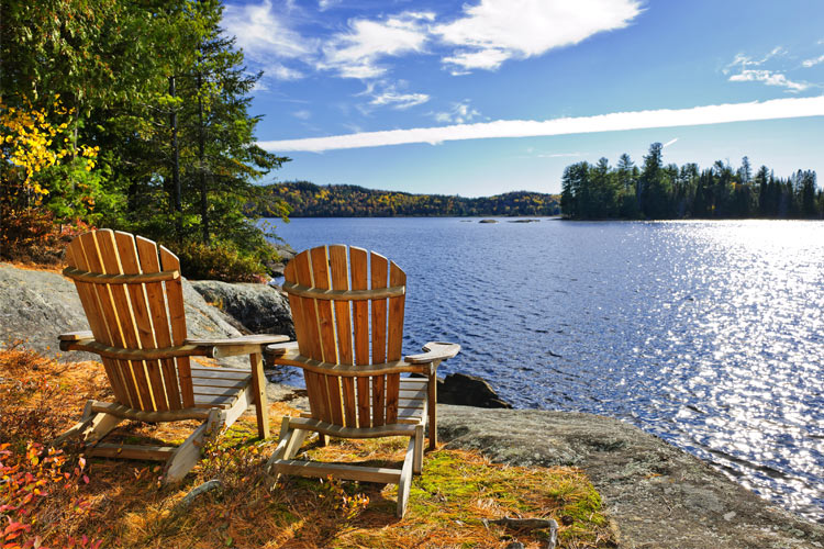 adirondack chairs near lake