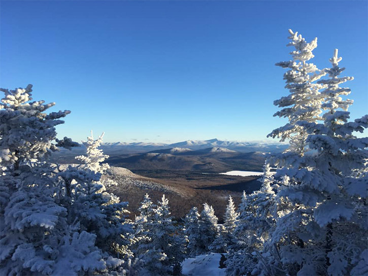 view from mountain summit in the winter