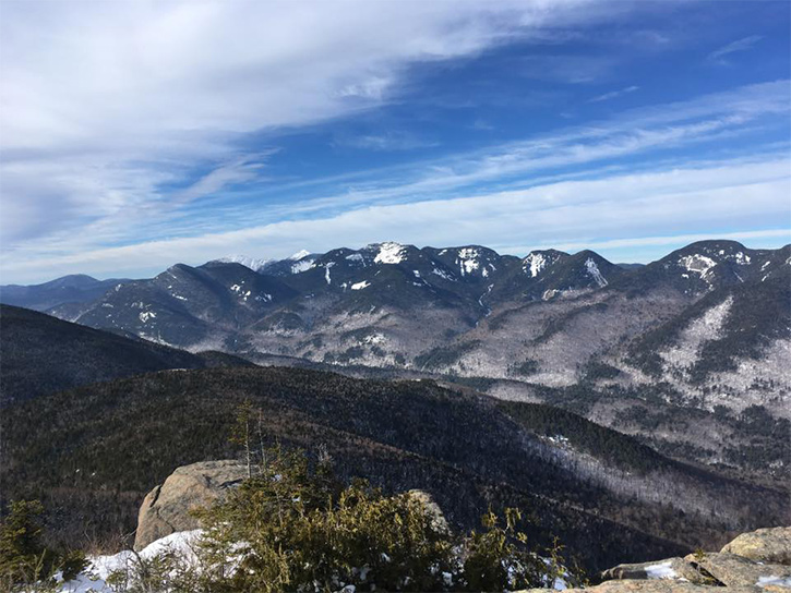 view from noonmark mountain summit in the winter