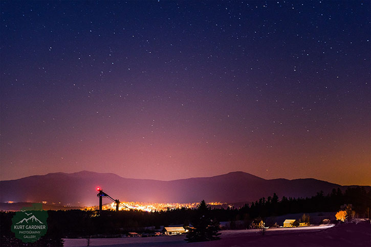 ski jumps outside lake placid under starry sky