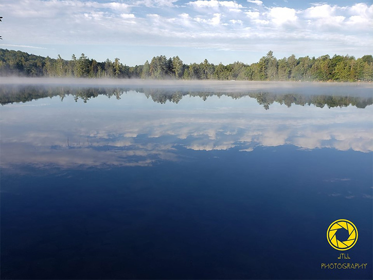 mist on a lake in the morning