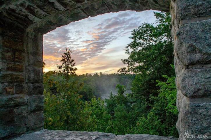 Sunrise through window in a stone bridge