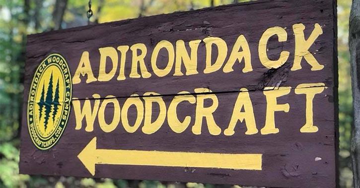 adirondack woodcraft camps sign