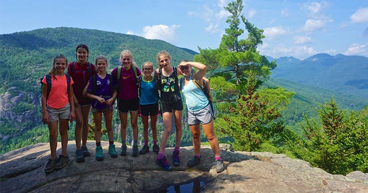 seven campers on a mountain summit