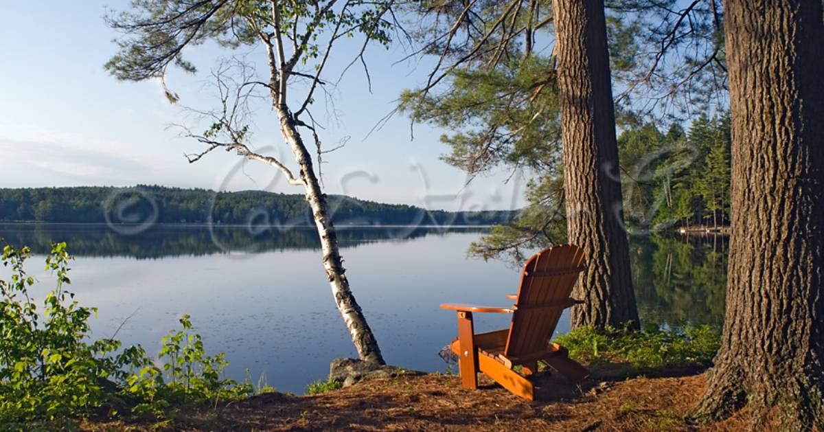 Adirondack chair by lake