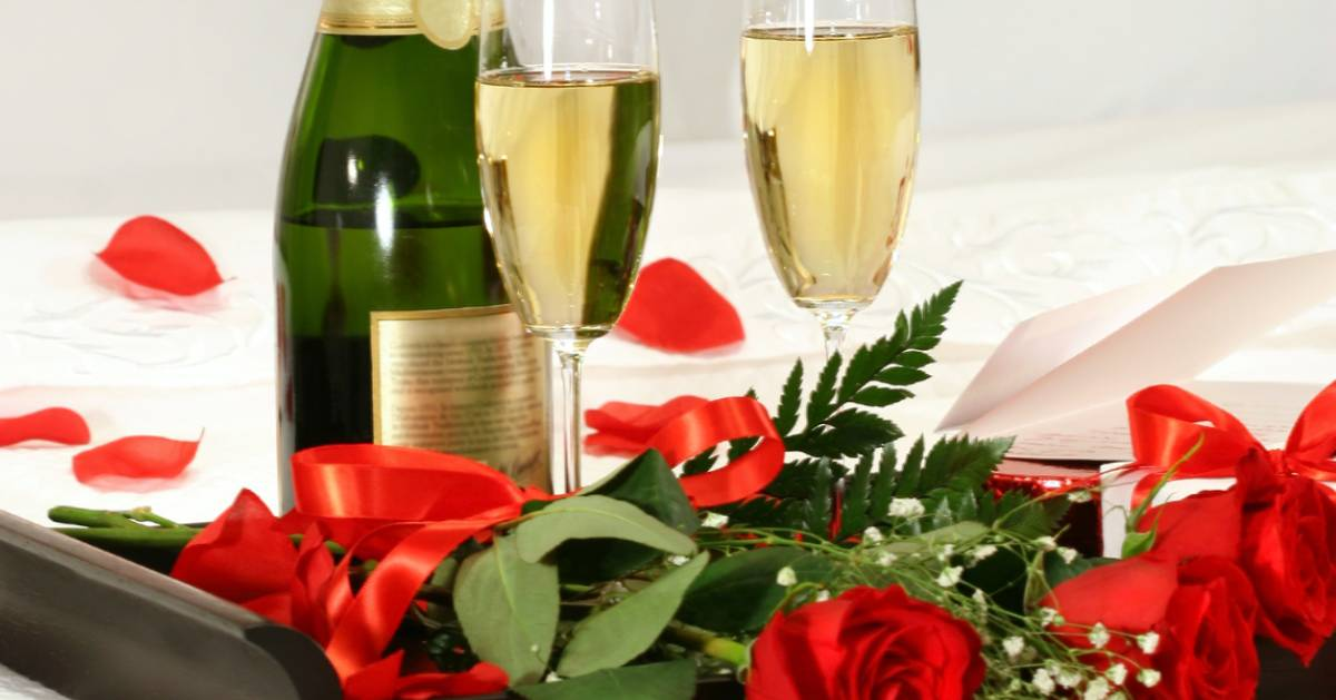close up of champagne and roses