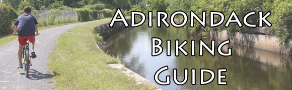 person biking on feeder canal trail
