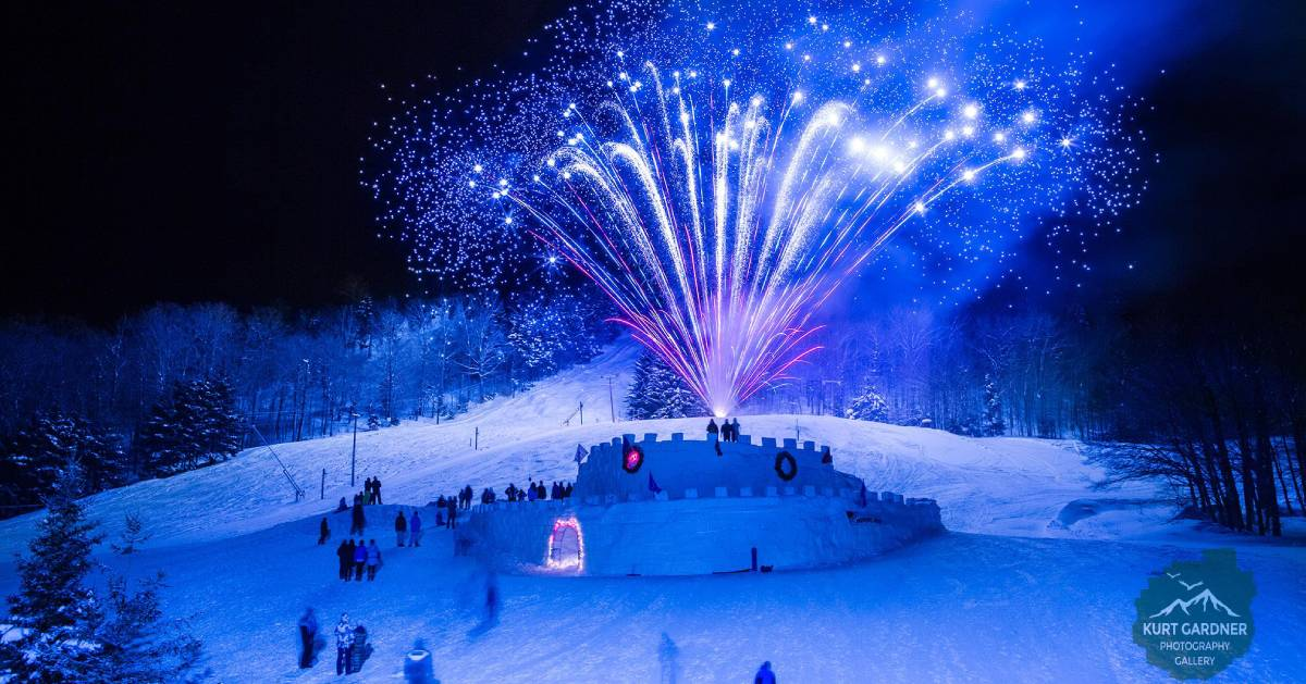 blue fireworks over winter carnival