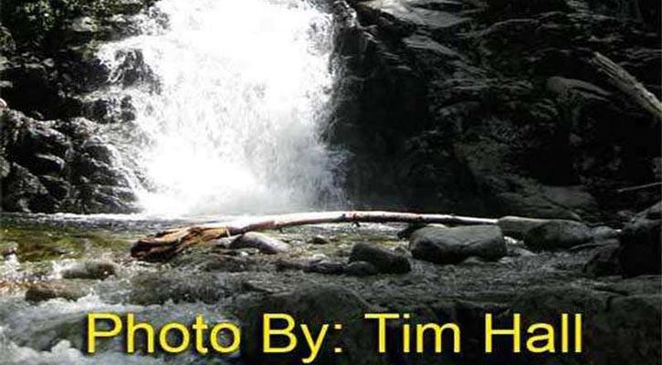 a waterfall going down rocks