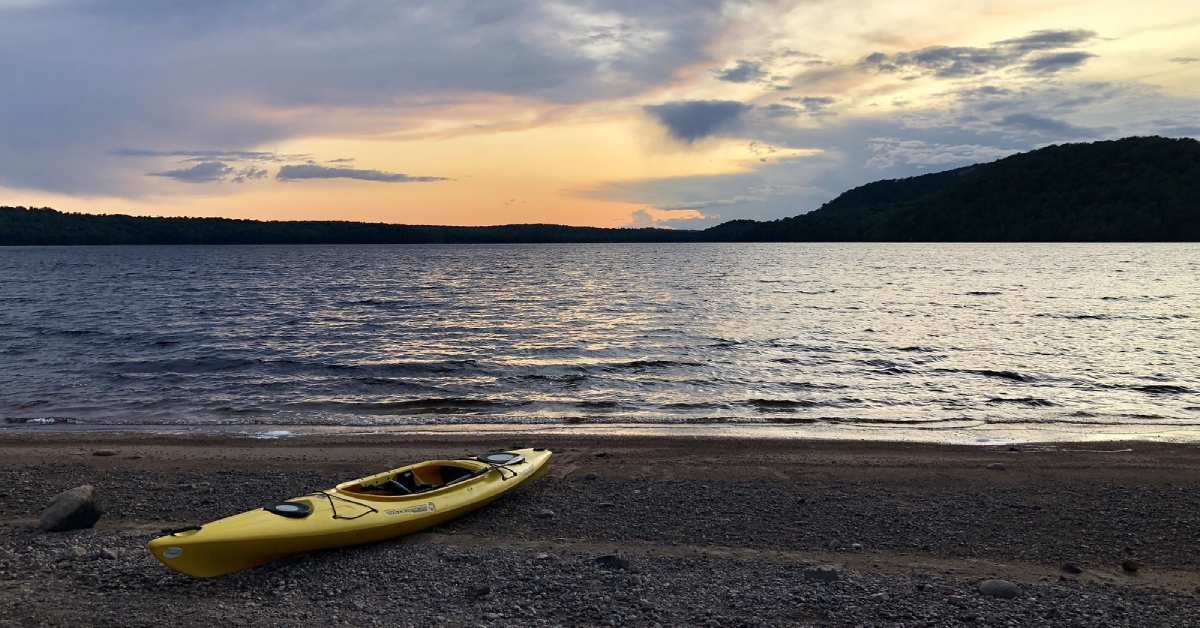a kayak on the shore of carry falls reservior
