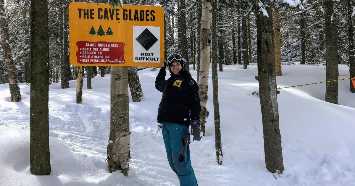 cave glades sign with guy