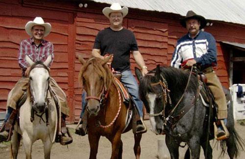 three horseback riders