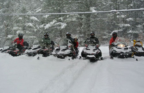 snowmobile riders