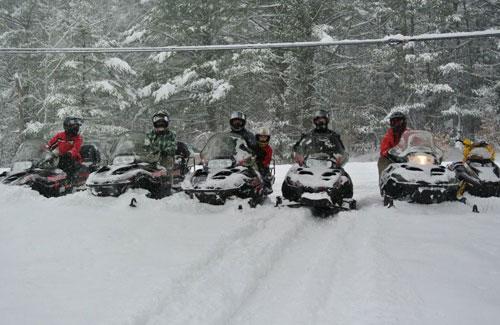 snowmobile riders