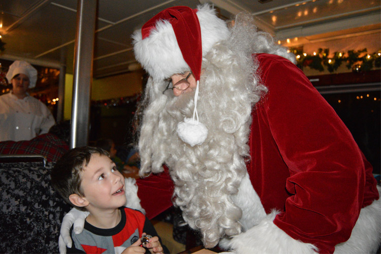 boy and santa on a train
