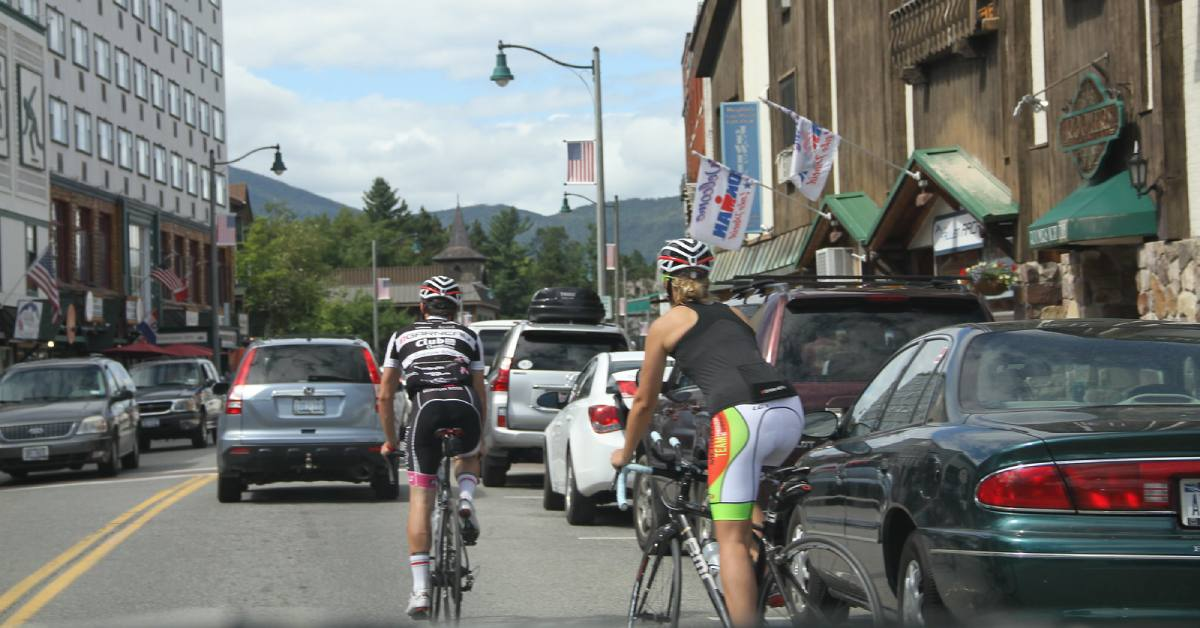cyclists riding alongside traffic in lake placid