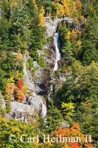 roaring brook falls surrounded by fall foliage