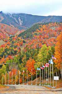 flags in front of Whiteface Mountain with fall foliage