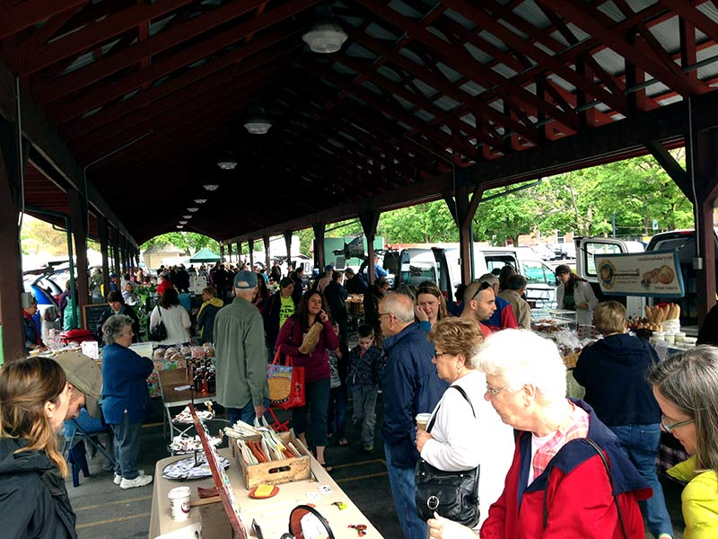 customers strolling a farmers market
